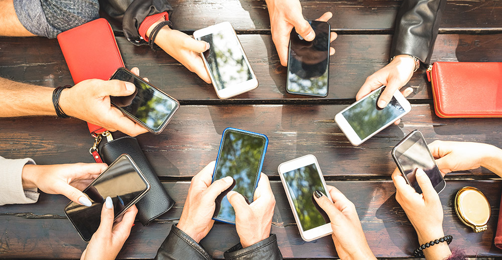 People group having addicted fun together using smartphones personalized mobile marketing strategies