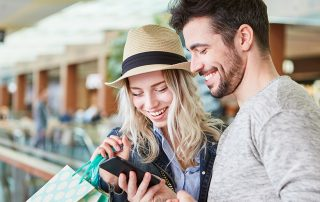 Couple shopping uses smartphone app